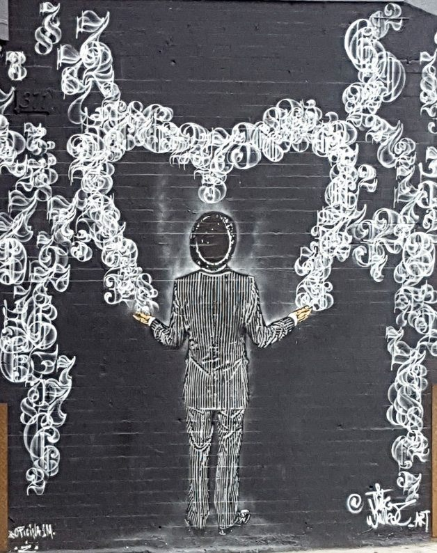 Black and white man in pin strip suit holding heart street art