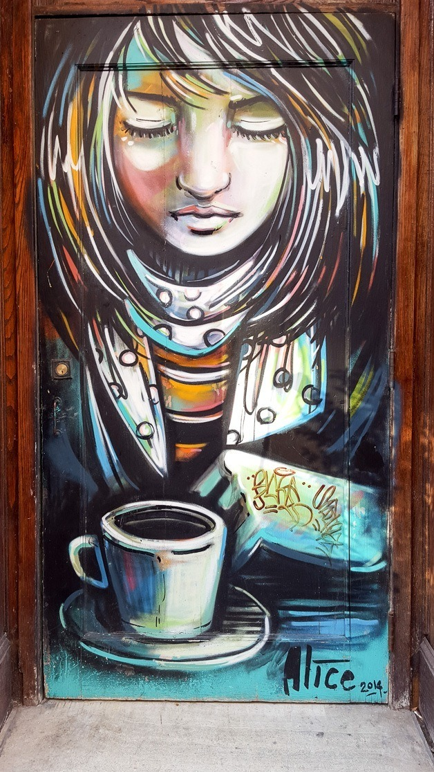 Girl with coffee cup street art