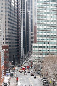 Traffic on New York streets with tall buildings