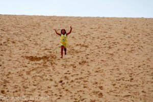 A child at the Beginning of Running Down the Dune Climb