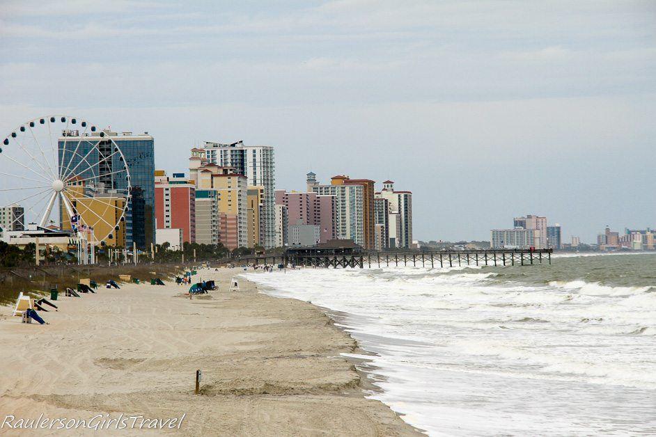 Myrtle Beach beachfront view with pier and ferris wheel