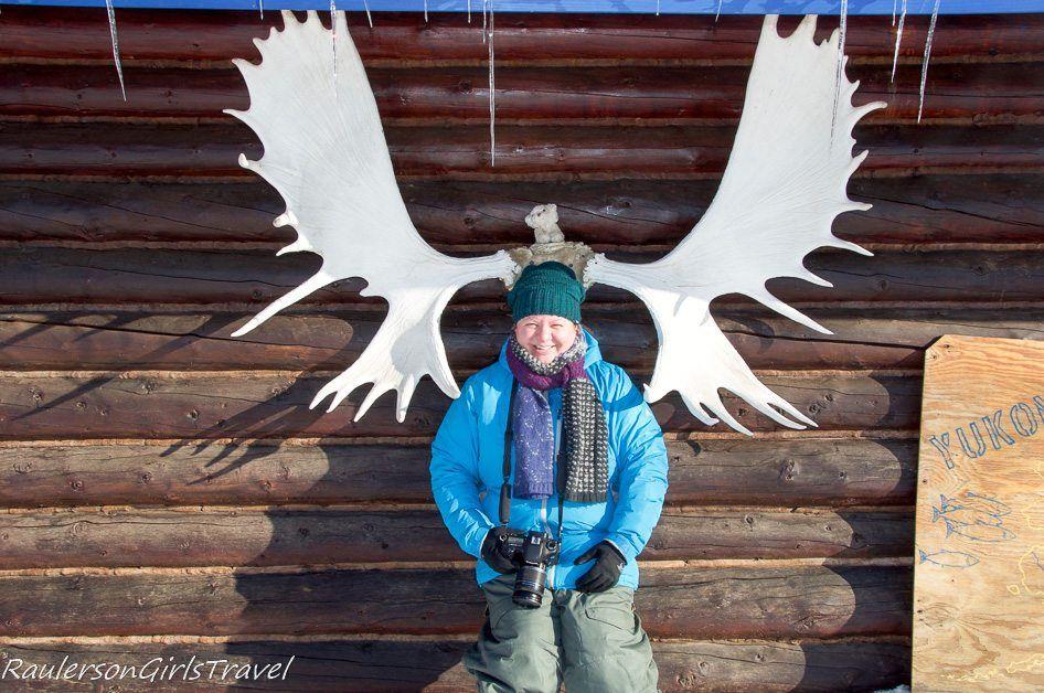 Heather Raulerson posing with moose antlers in Beaver Village Alaska