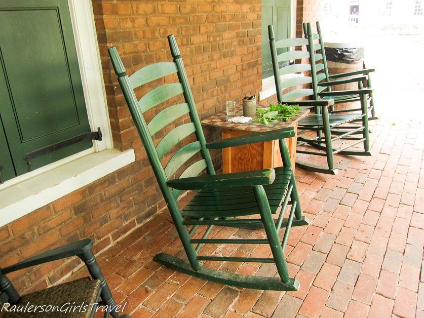 Rocking Chairs sitting next to a checker board & vegetables