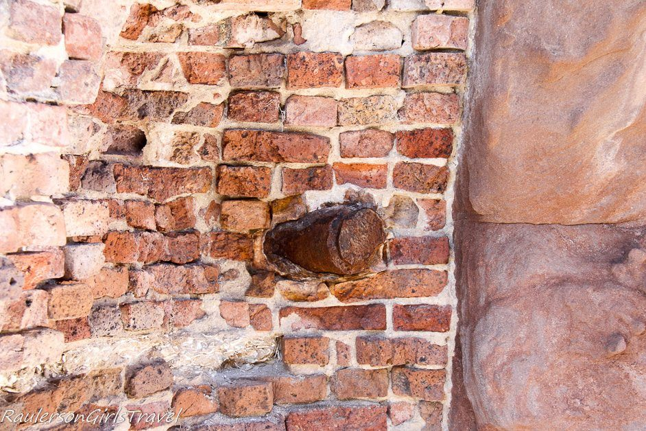 Projectile protruding from wall at For Sumter