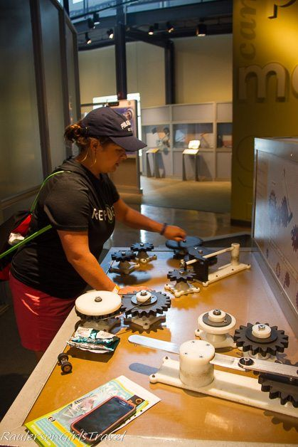 Kayla trying to make the gears work at the Franklin Institute