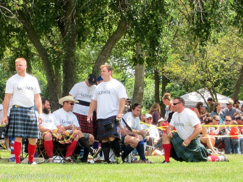 Athletes participating in The Cabor Toss at the Highland Games