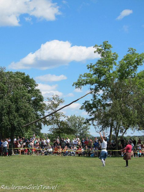 Cabor mid toss at the Highland Games