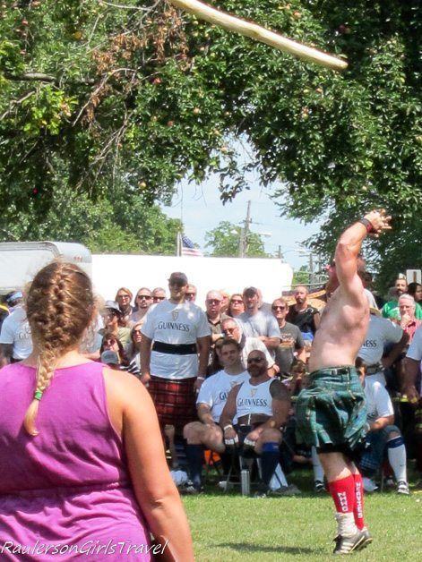 Letting go of the Cabor at the Highland Games no shirt