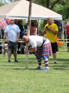 Picking up the cabor at the highland Games