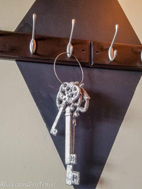 Keys hanging on a coat hook at Mad Hatter Bistro