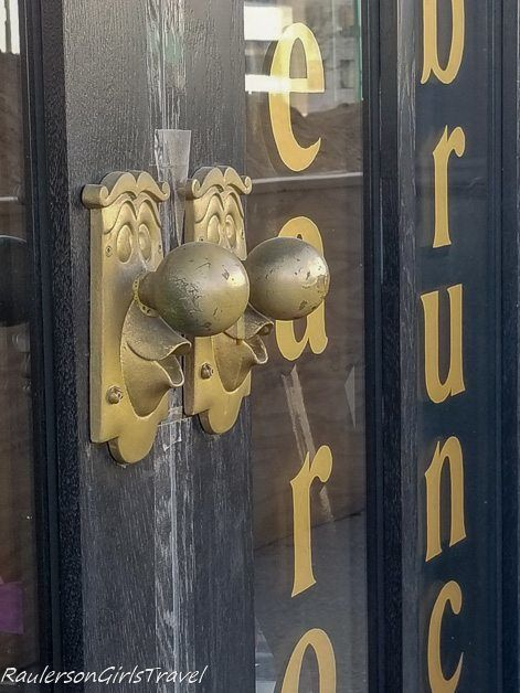 Door Knobs outside Mad Hatter Bistro - Ready to Step into Wonderland At The Mad Hatter Bistro