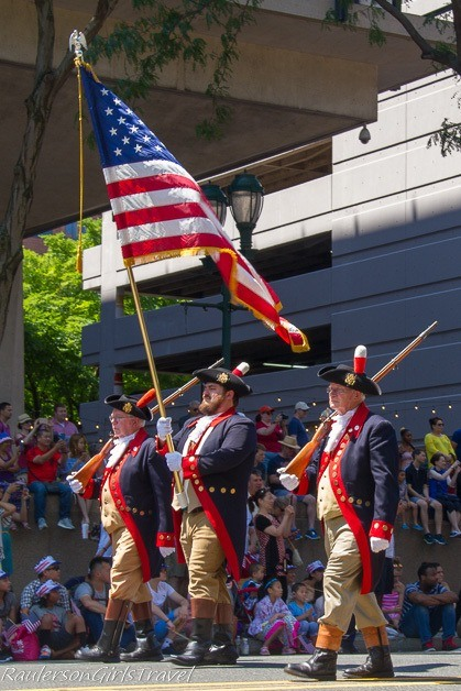 Soldiers holding the American Flag in Philadelphia's Independence Day Parade - Celebrate America's Birthday