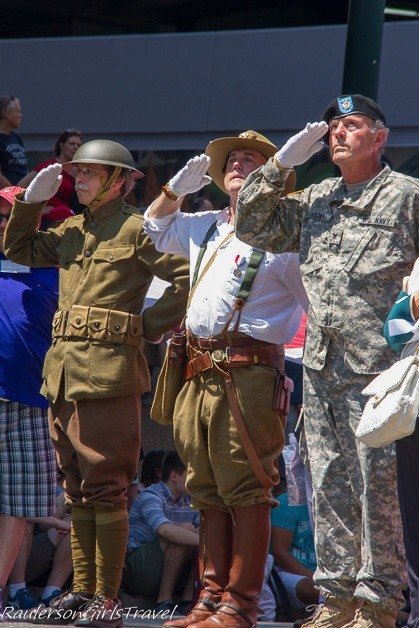 Soldiers saluting in the Independence Day Parade