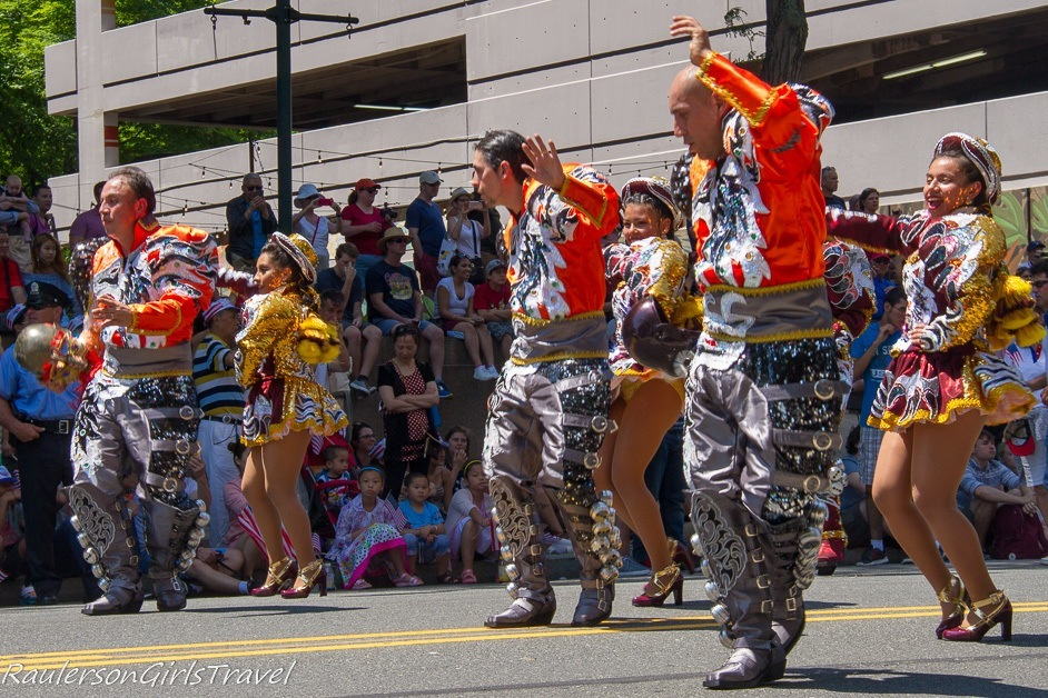 Dancing colorful people in the Independence Day Parade