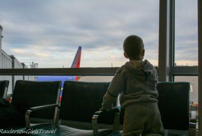 Alex watching the planes at the airport