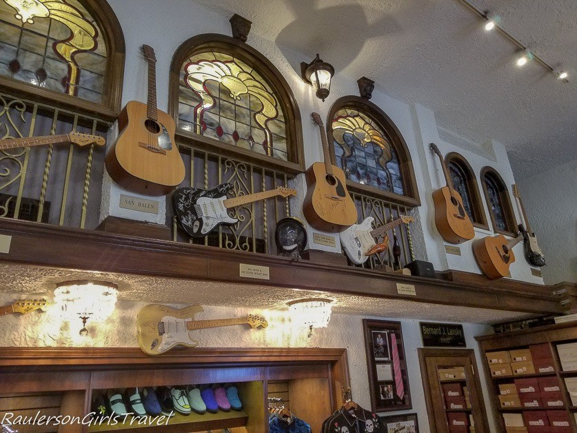Signed guitars and blue suede shoes at Lansky Bros.