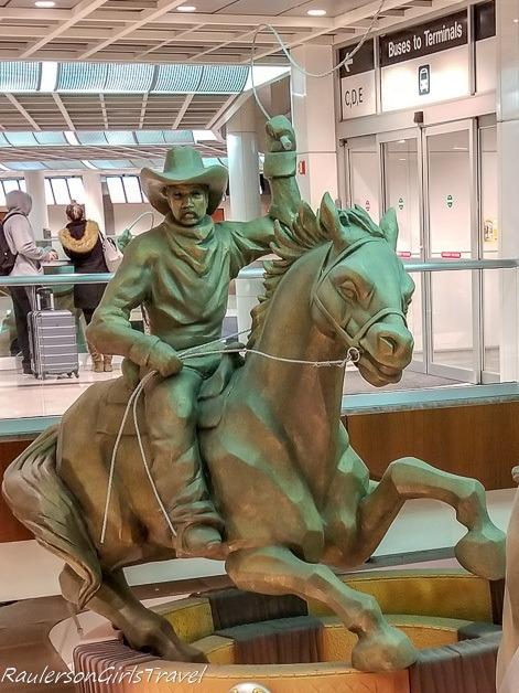 Cowboy on horse at Dallas airport car rental