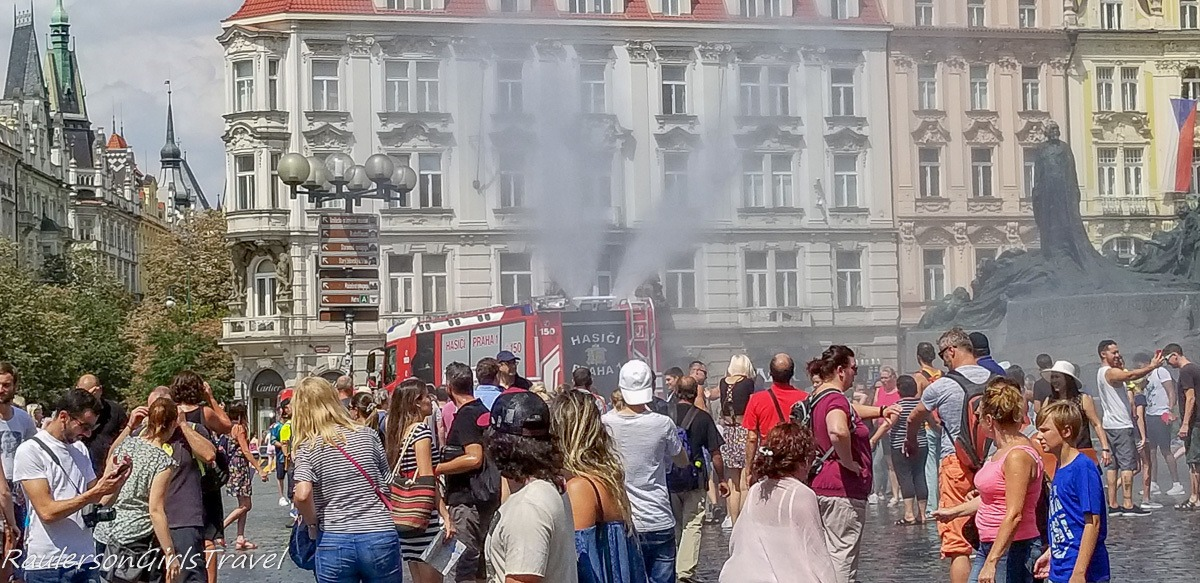 Fire engine spraying the crowd in Prague