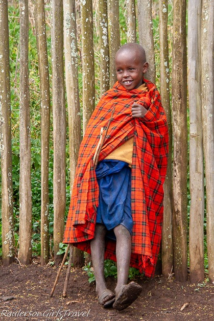 Young boy hanging out by the fence