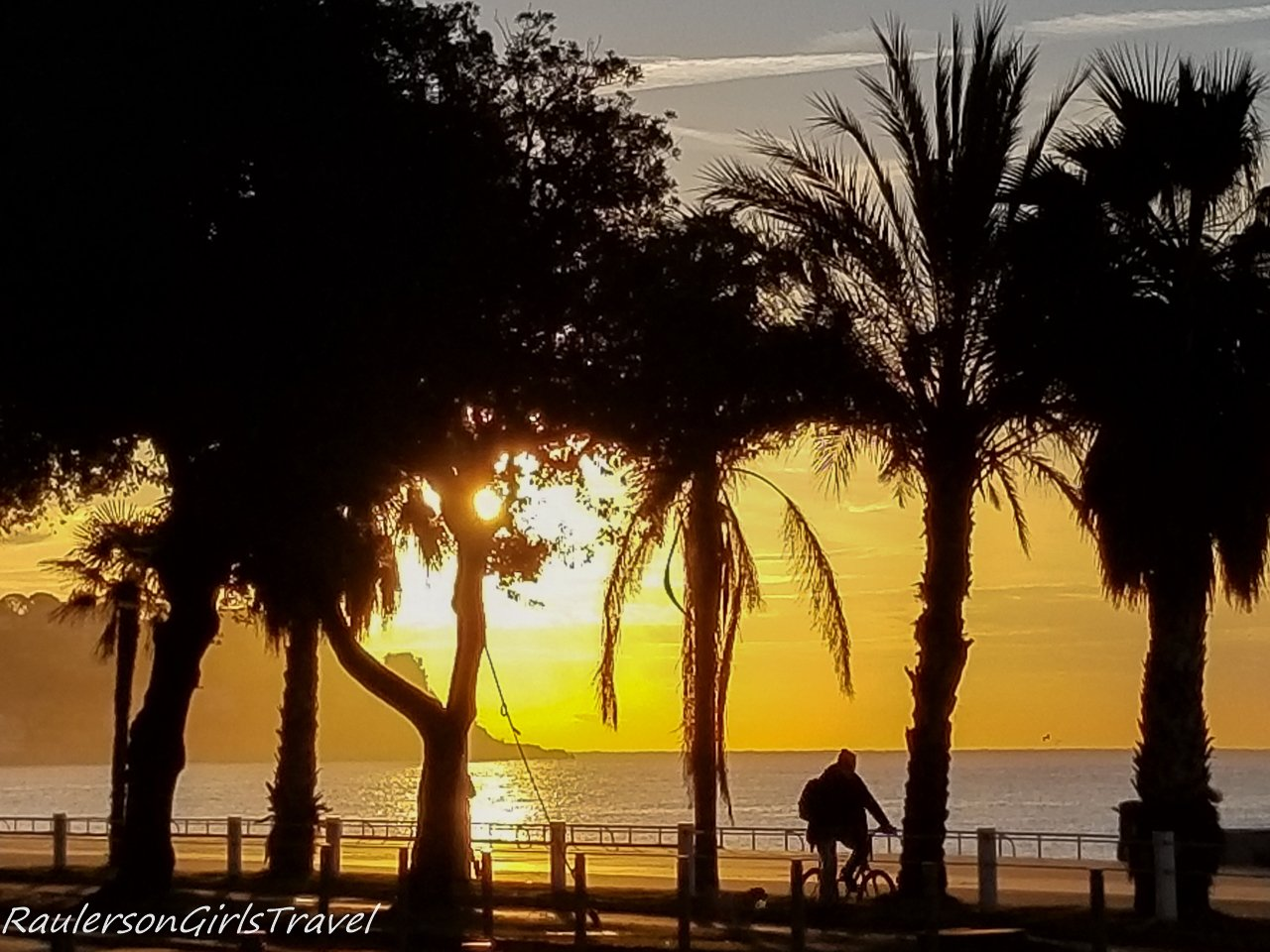 Sunrise with a biker silhouette in Nice