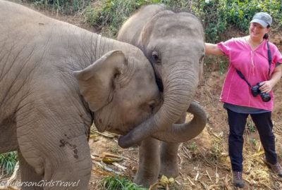 Heather petting baby elephant
