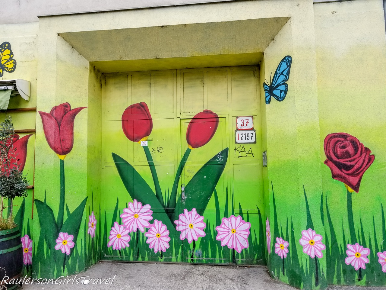 Flowers and butterflies on side of building in Bratislava