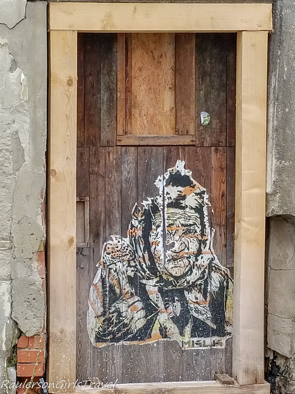 Old woman in door