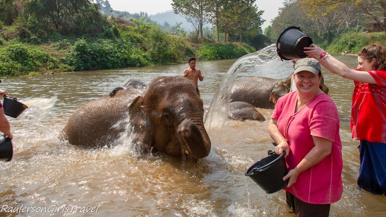 Heather bathing an elephant