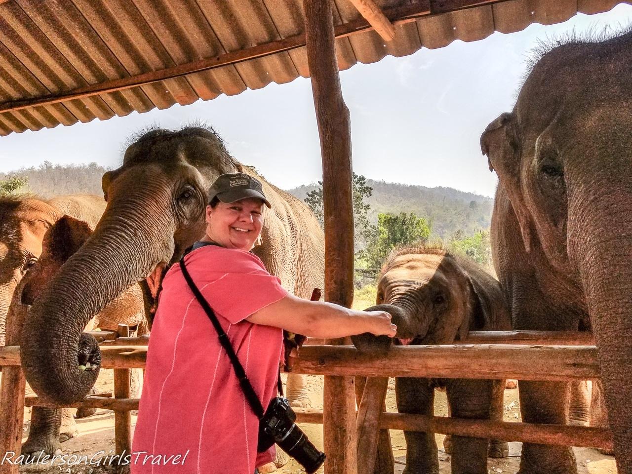 Heather feeding the baby elephant