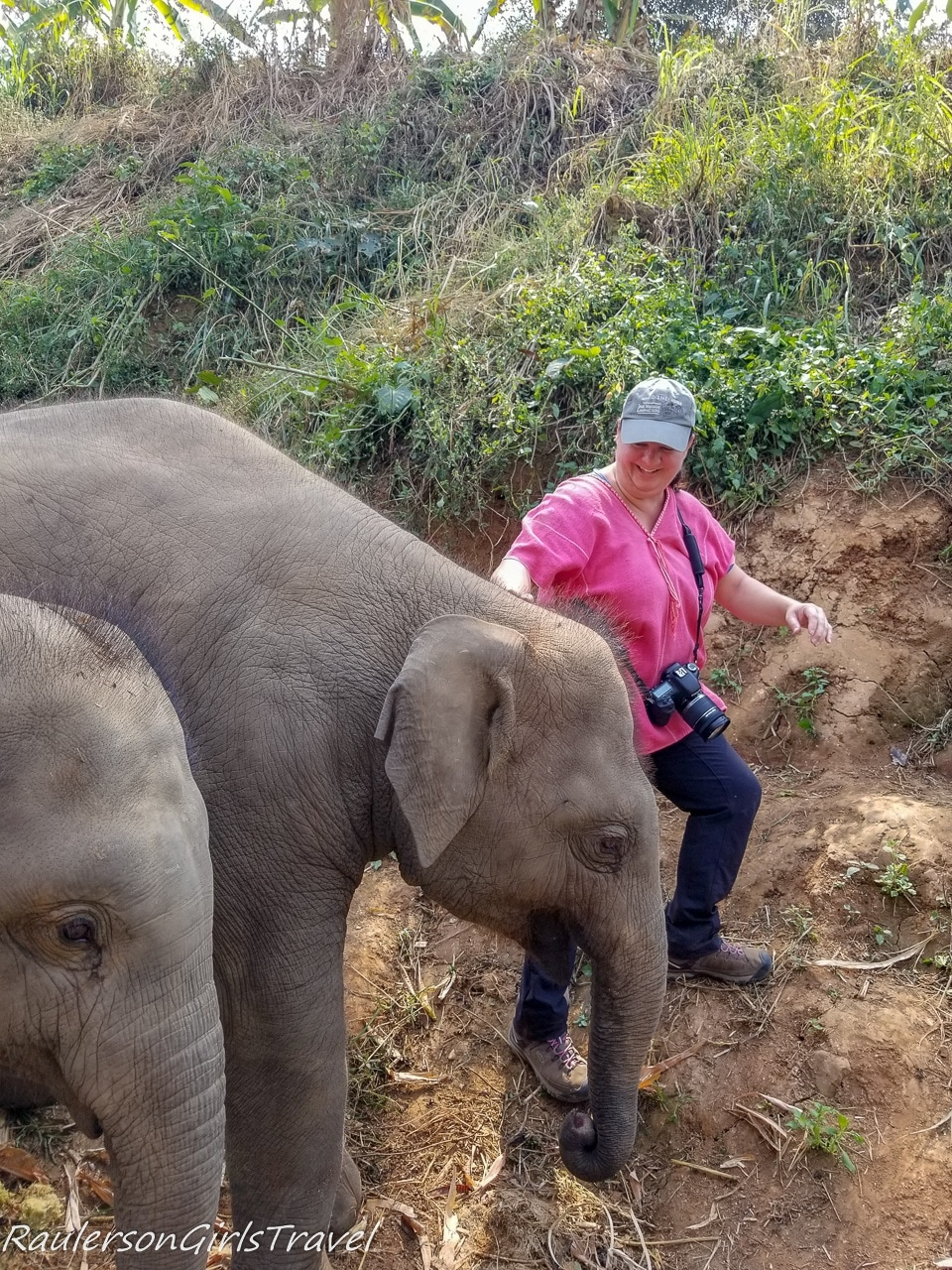 Heather getting out of the way of the baby elephant