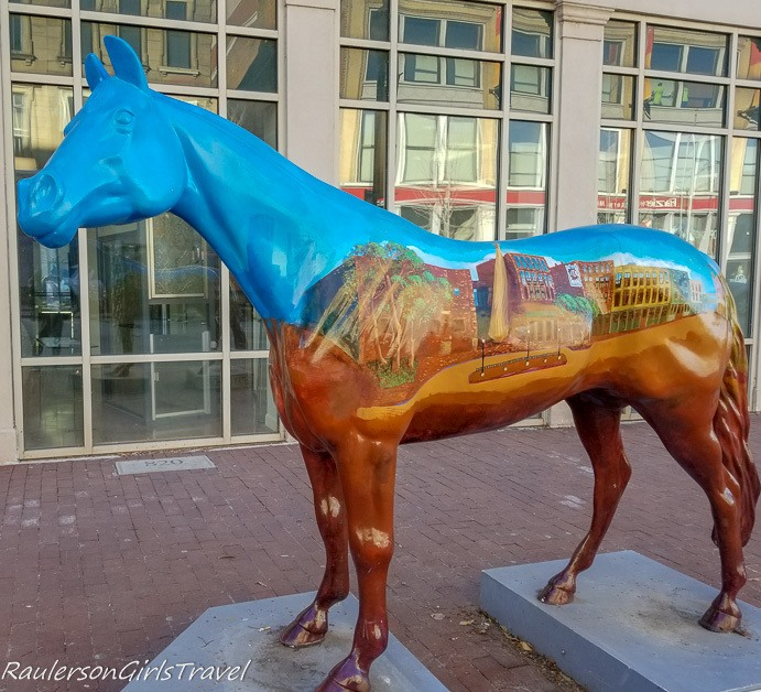 Horse statue painted with the Louisville downtown