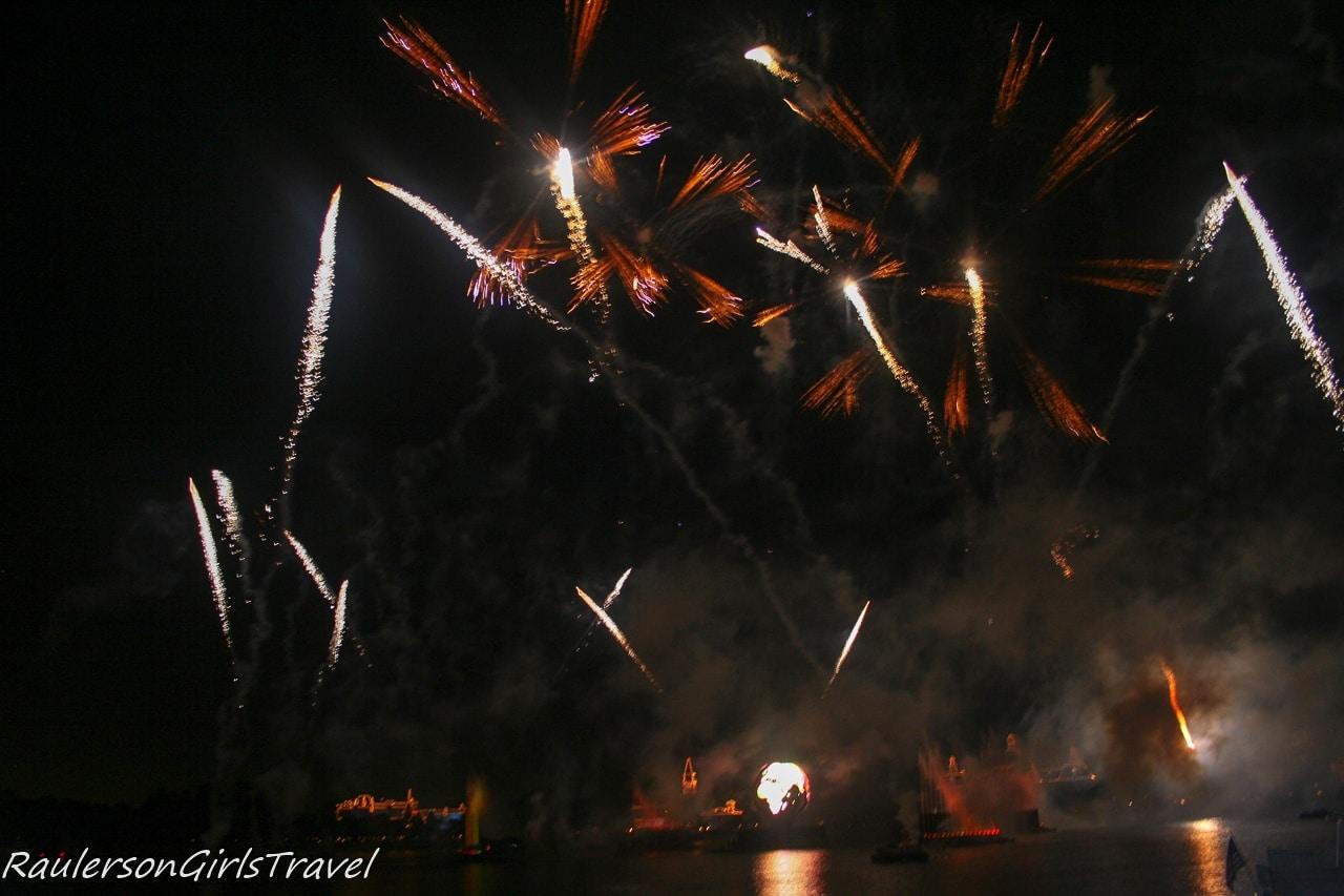 Illuminations Earth Globe and fireworks shooting everywhere