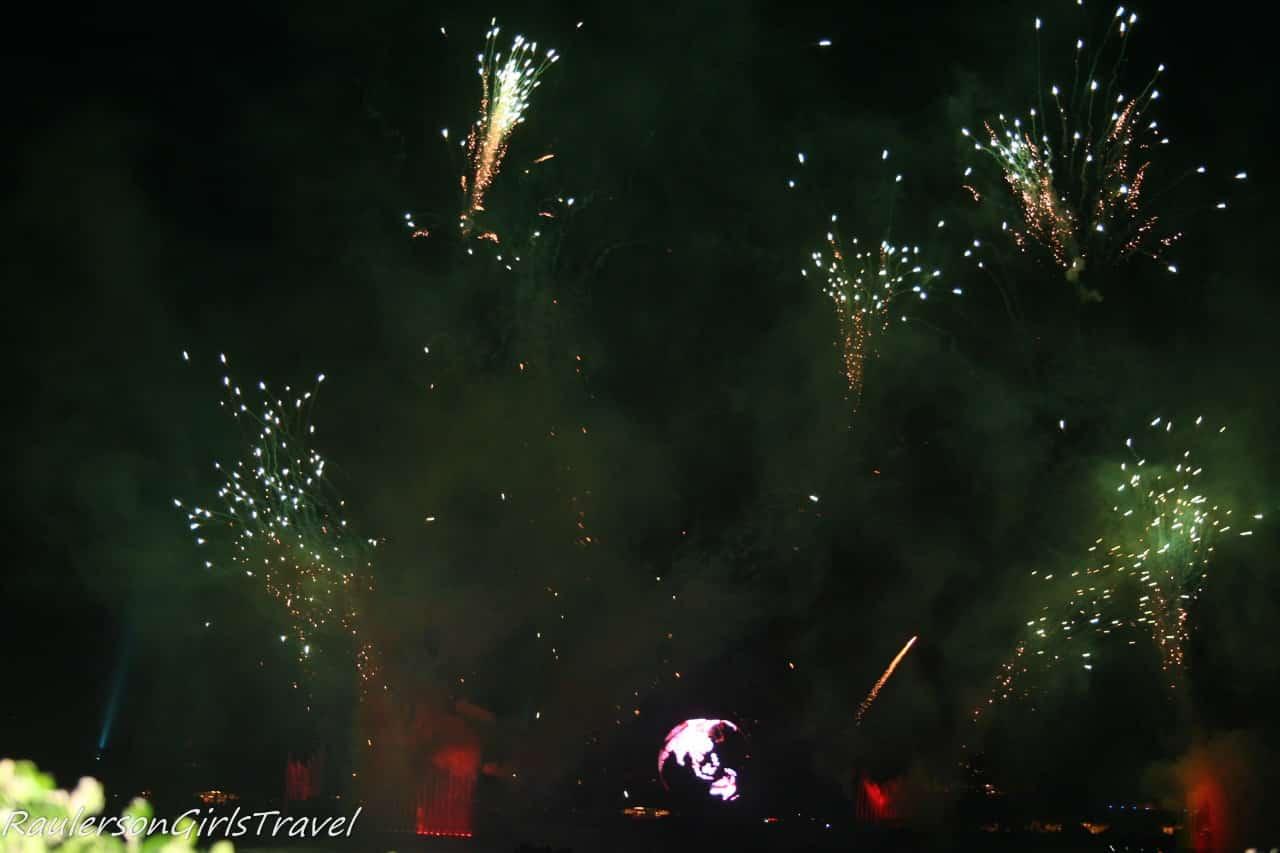 Illuminations Earth Globe and green fireworks