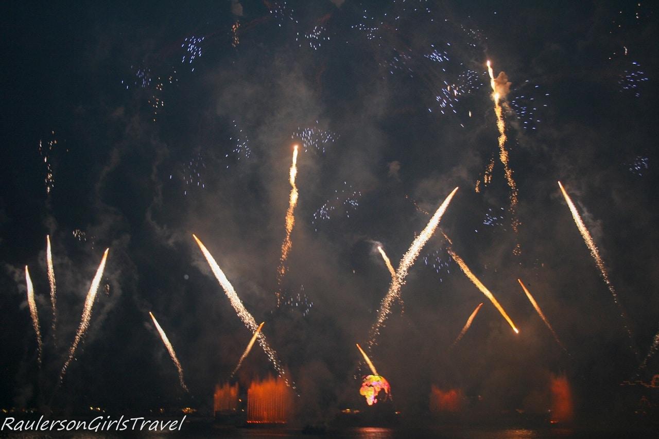 Illuminations Earth Globe and white fireworks