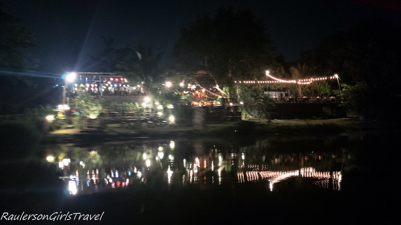 Riverbanks illuminated on the Mae Ping River