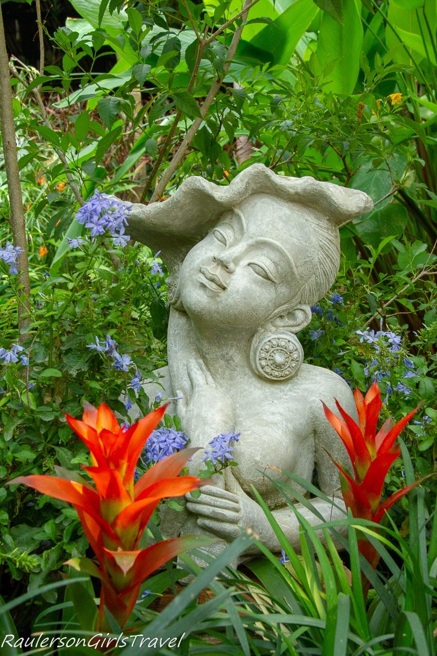 Statue and orange flowers