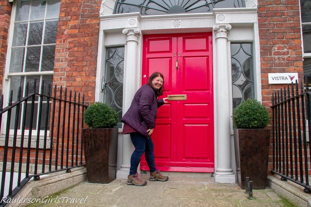 Posing in front of a pink door in the Georgian area of Dublin