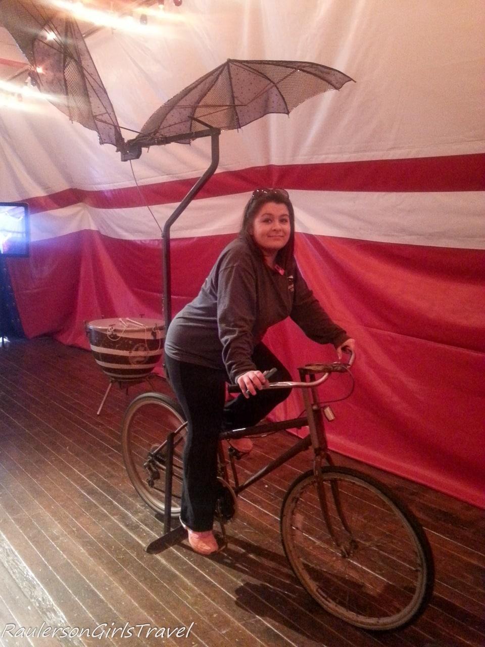 Kayla pedaling the flying bike