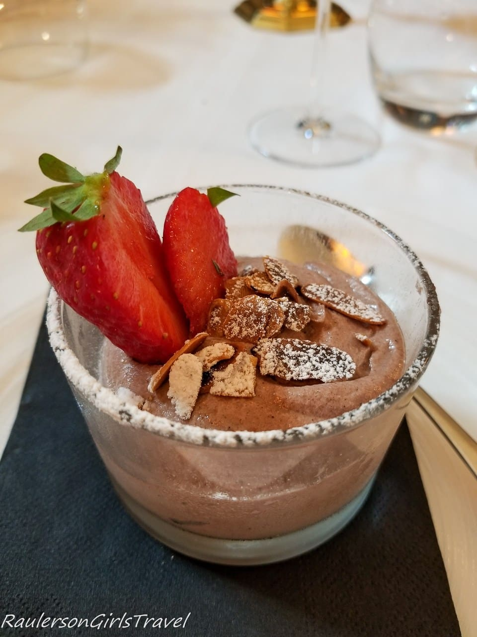 Chocolate mousse served with strawberries and almond crumble