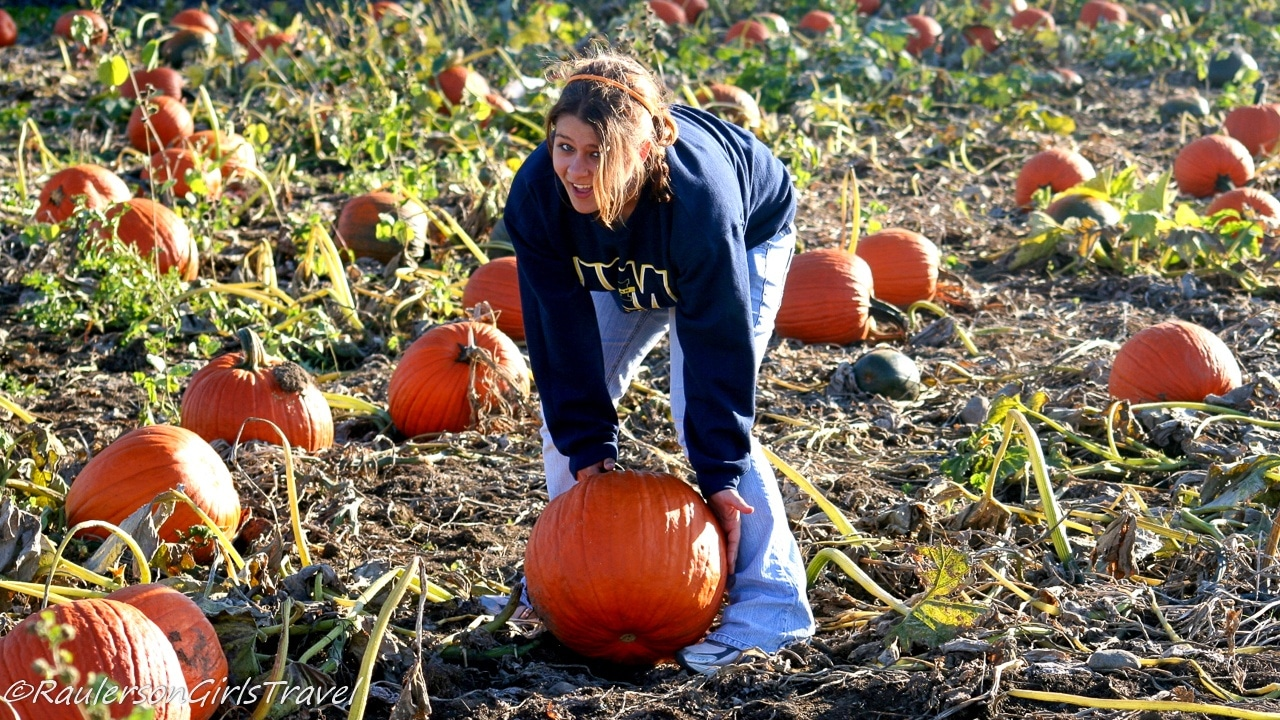 Kayla picking pumpkins at Blake's Cider Mill