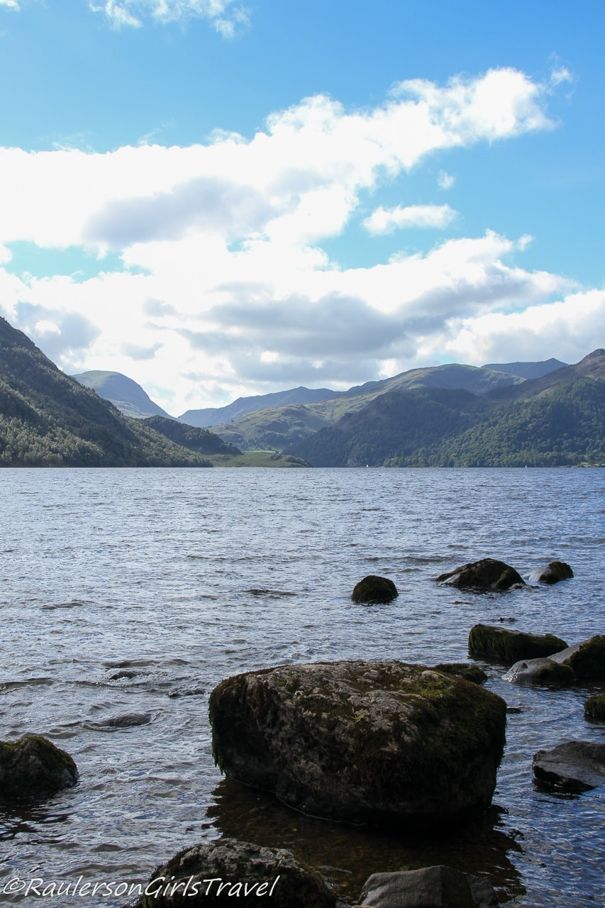 Scenic view of Ullswater with rocks in foreground