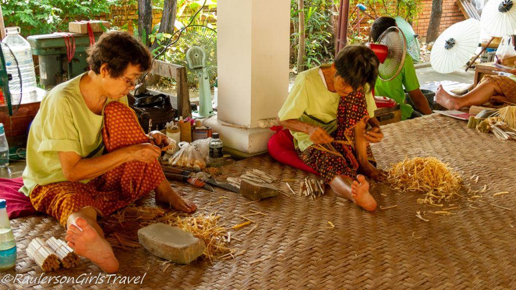 Thai ladies cutting bamboo for umbrellas at the Romborsang Umbrella Factory