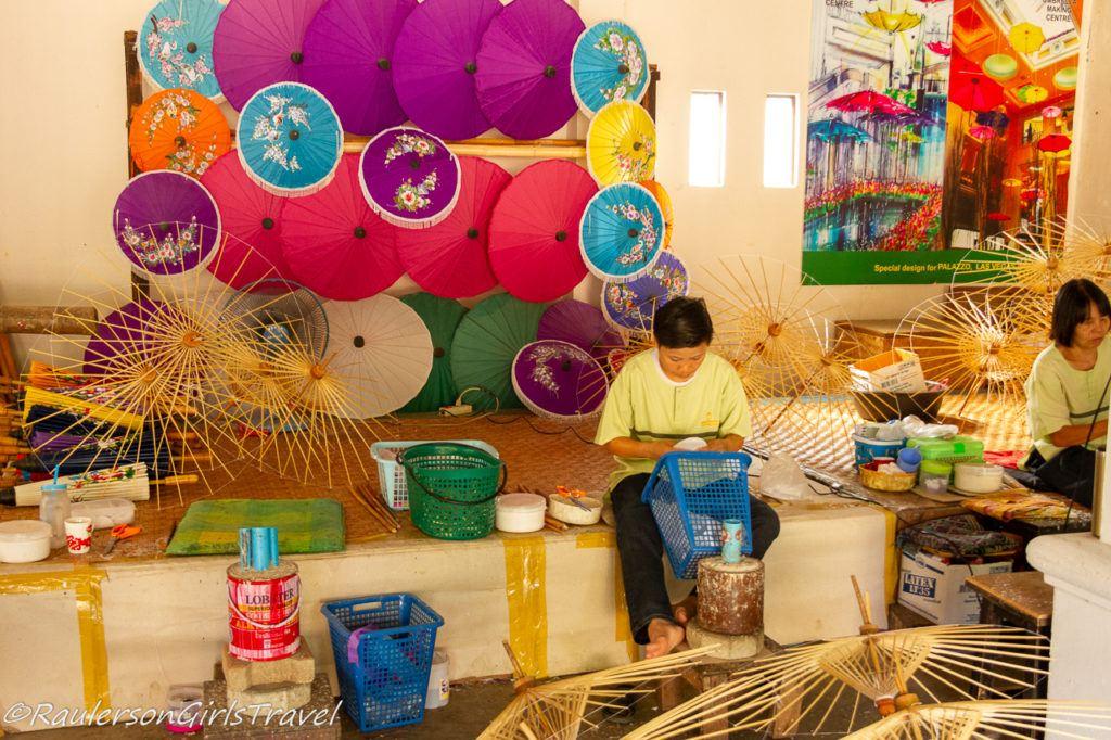 Thai ladies finishing making umbrellas at the Romborsang Umbrella Factory