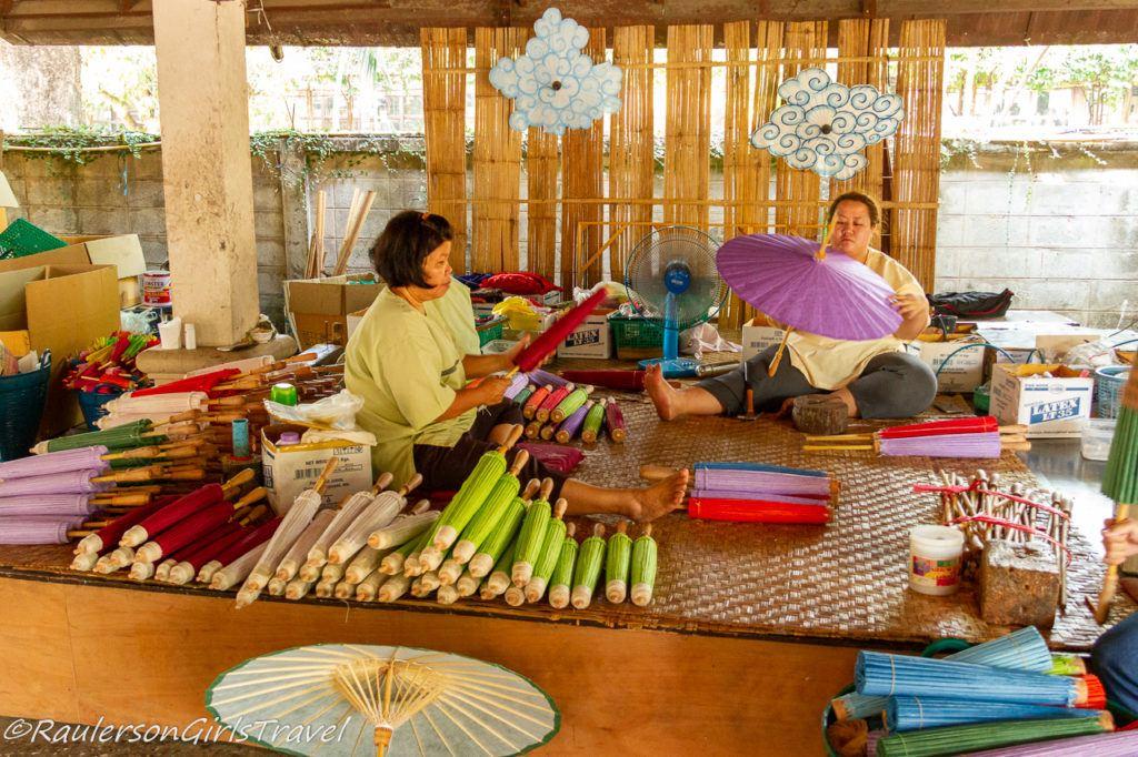 Finishing making umbrellas at the Romborsang Umbrella Factory