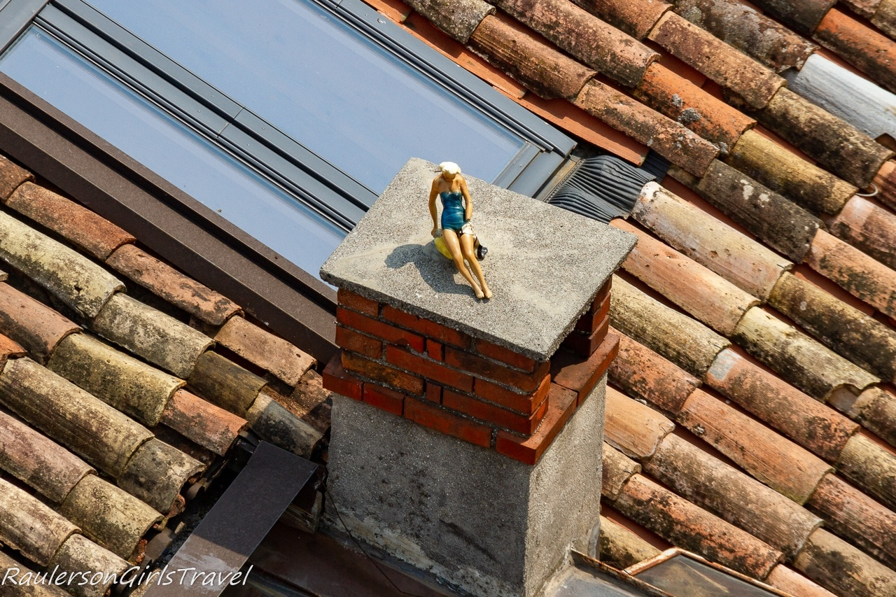 Barbie doll sunning on a roof in Riva del Garda