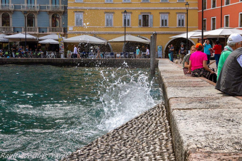 Water splashing into the retaining wall in Riva del Garda