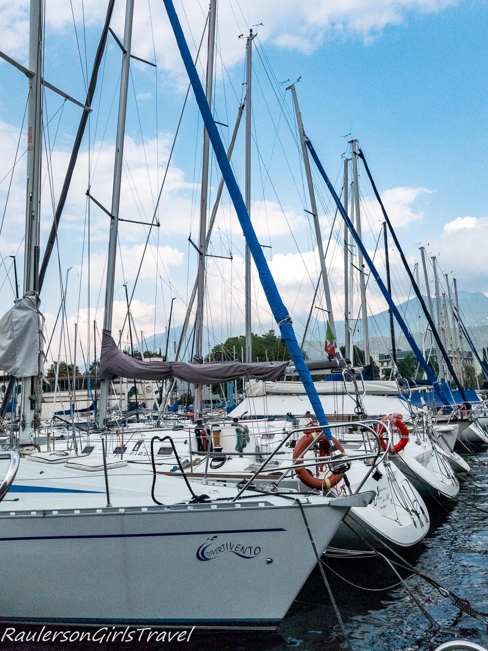Sailboats docked in the marina in Riva del Garda