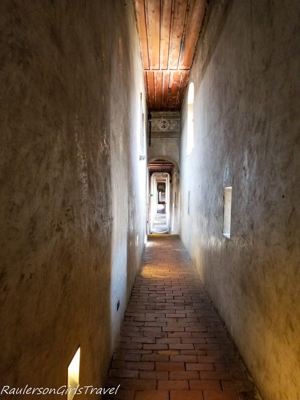 Hallway toward Torre Aquila