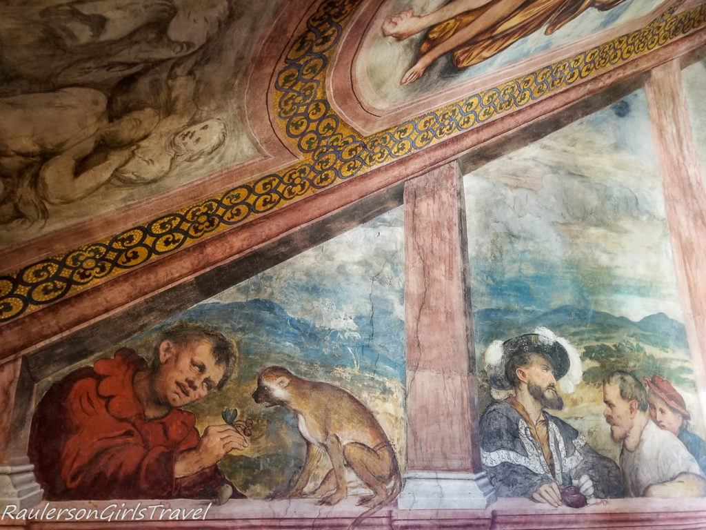 Fresco - the court jester is depicted playing with a monkey and an elegantly dressed man, a superintendent of the works of the Great Palace, while he pays the workers involved in the yard