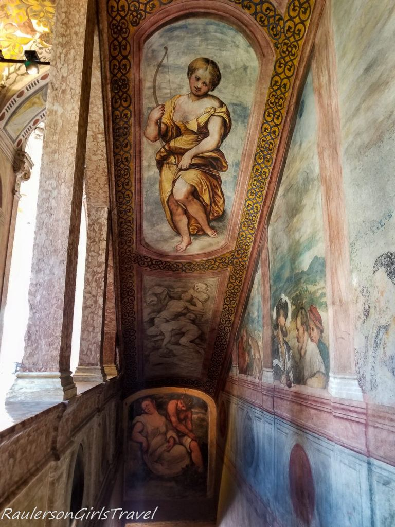 Fresco - In the ceiling of the staircase stands elegant Diana, between two magnificent monochromes with mythological themes.